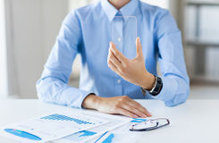 Close up of woman with transparent smartphone Royalty Free Stock Photos