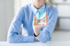 Close up of woman with transparent smartphone Stock Photo