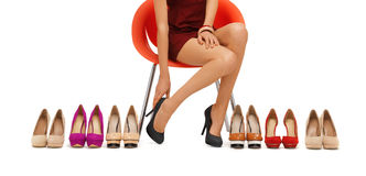 Close up of woman trying on high heeled shoes stock images