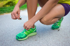 Close up of woman tying shoe laces Royalty Free Stock Images