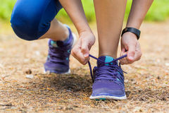 Close up of woman tying shoe laces in summer workout. Royalty Free Stock Photos
