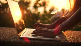 Close Up Woman Typing on Laptop Keyboard Againts Beautiful Beach Sunset. 4K, Slowmotion. Phuket, Thailand. Close Up Woman Typing on Laptop Keyboard Againts stock footage