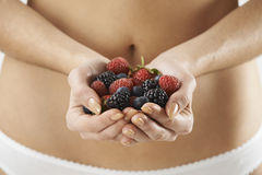 Close Up Of Woman In Underwear Holding Fresh Summer Berries stock image