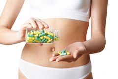 Close Up Of Woman In Underwear Taking Generic Pills From Bottle. Woman In Underwear Taking Generic Pills From Bottle Royalty Free Stock Photos