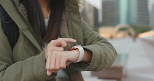 Close up of woman use of smart watch, woman wearing winter jacke. T at outdoor Royalty Free Stock Image