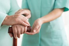 Close-up of woman using cane stock photo
