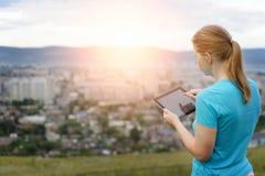 Close up woman using digital tablet. Stock Photos