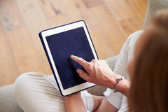 Close Up Of Woman Using Digital Tablet At Home Stock Photo