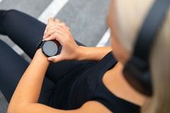 Close-up of woman using fitness smart watch device before running royalty free stock photos
