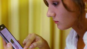 Close up woman using her cell phone. Video Stock Photography