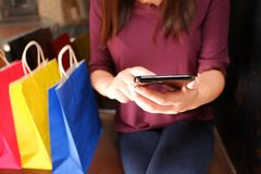Close-up of woman using her smartphone during shopping stock photos