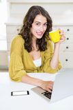 Close up of woman using laptop and having coffee Royalty Free Stock Image