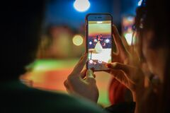 Close-up of Woman Using Mobile Phone at Night Royalty Free Stock Image