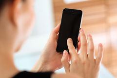 Close up of a woman using mobile smart Phone Stock Photo