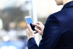 Close up of a woman using mobile Royalty Free Stock Image