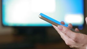 Close up of a woman using mobile smart phone. the background monitor. Close up of a woman using mobile smart phone stock video footage