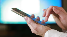 Close up of a woman using mobile smart phone. the background monitor. Close up of a woman using mobile smart phone stock video