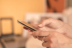 Close up of a woman using mobile smart phone indoor Royalty Free Stock Photos