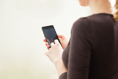 Close up of a woman using mobile smartphone Stock Photo