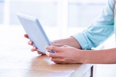 Close up of woman using tablet in meeting Stock Photography