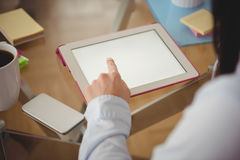 Close up of woman using tablet. At table in home Royalty Free Stock Photos