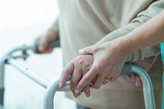 Close-up of woman using walker stock images