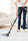 Close up of woman with vacuum cleaner at home Stock Photo