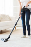 Close up of woman with vacuum cleaner at home Stock Photos