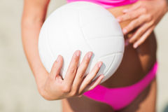 Close up of woman with volleyball ball on beach Stock Photos
