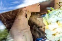 Close-up woman waiting in the car Stock Photos