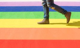 Close up of woman walking on LGBT colored ground. Close up of woman walking on ground colored to resemble the pride / LGBT flag Stock Photography