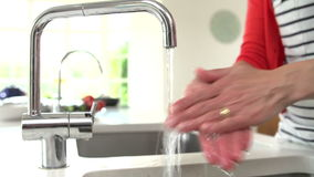 Close Up Of Woman Washing Hands In Kitchen Sink stock footage