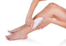 Close-up Of Woman Waxing Legs Stock Photography