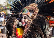 SAN ANTONIO, TEXAS - OCTOBER 29, 2017 - Woman wearing Aztec headdress for Dia de Los Muertos/Day of the Dead celebration. Close up of woman wearing Aztec Royalty Free Stock Photos