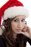Close up of woman wearing christmas hat Royalty Free Stock Photos