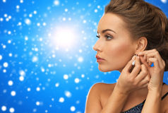 Close up of woman wearing earrings Stock Image