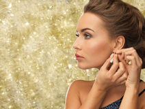 Close up of woman wearing earrings Royalty Free Stock Images