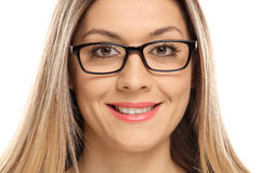 Close-up of a woman wearing eyeglasses and smiling Royalty Free Stock Image