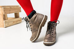 Close-up of woman wearing fashionable brown boots royalty free stock images