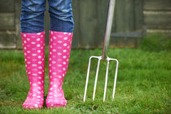 Close Up Of Woman Wearing Pink Wellingtons Holding Garden Fork Stock Photos