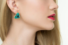 Close up of woman wearing shiny diamond earrings Royalty Free Stock Photography
