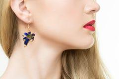 Close up of woman wearing shiny diamond earrings Royalty Free Stock Image