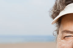 Close up of woman wearing a sun visor Royalty Free Stock Images