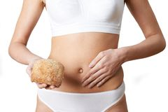Close Up Of Woman Wearing Underwear Holding Bread Roll And Touch stock photos