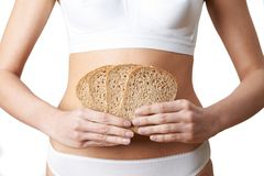 Close Up Of Woman Wearing Underwear Holding Slices Of Brown Bread stock image