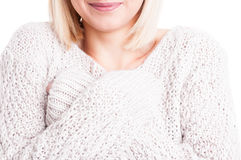 Close-up of woman wearing warm sweter with arms crossed Royalty Free Stock Photography