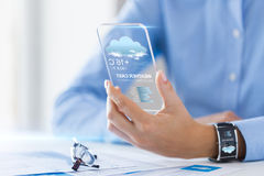 Close up of woman with weather app on smartphone Royalty Free Stock Photos