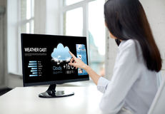 Close up of woman with weather cast on computer Royalty Free Stock Photography