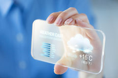 Close up of woman with weather cast on smartphone Stock Image
