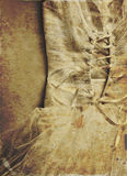 Close up of woman wedding dress with texture overly , sepia tones. Royalty Free Stock Photography